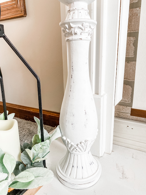 tall white painted candle holder