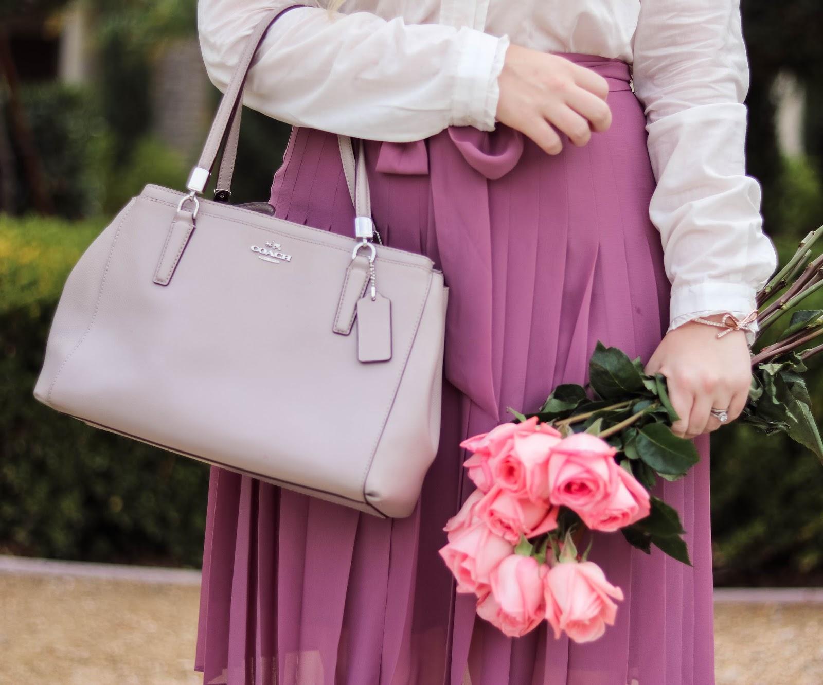 Elizabeth Hugen of Lizzie in Lace wears a grey coach bag