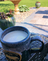 cup of coffee with patio and planters in hazy background
