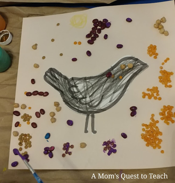 black bird clipart; beans glued onto paper to look like grapes