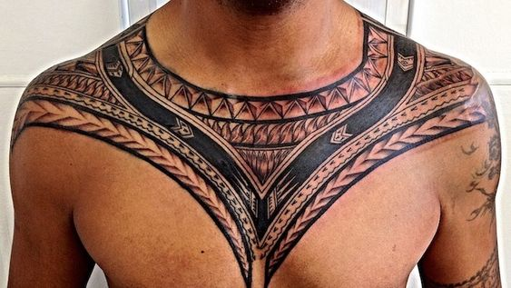 Tribal tattoo on chest for men