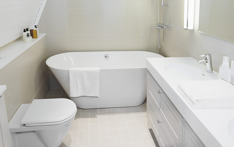 small bathroom with light tile