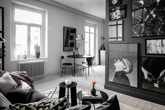 Garsonieră de 39 m² amenajată în negru și gri