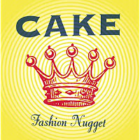 Yellow concentric circles with red crown and blue writing saying Cake Fashion Nugget