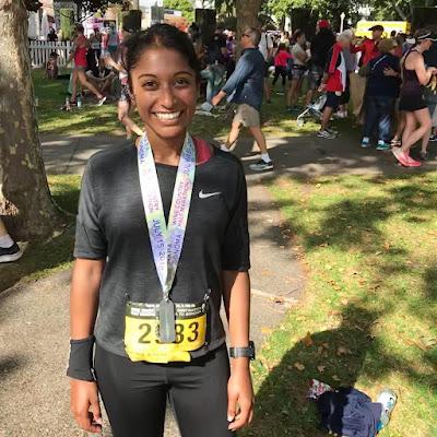 Tanya Senanayke with a finishers medal at the Napa to Sonoma Half Marathon
