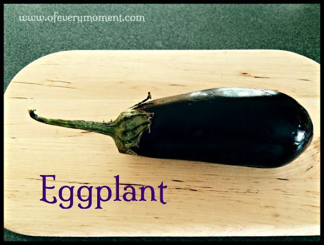 whole eggplant on a cutting board