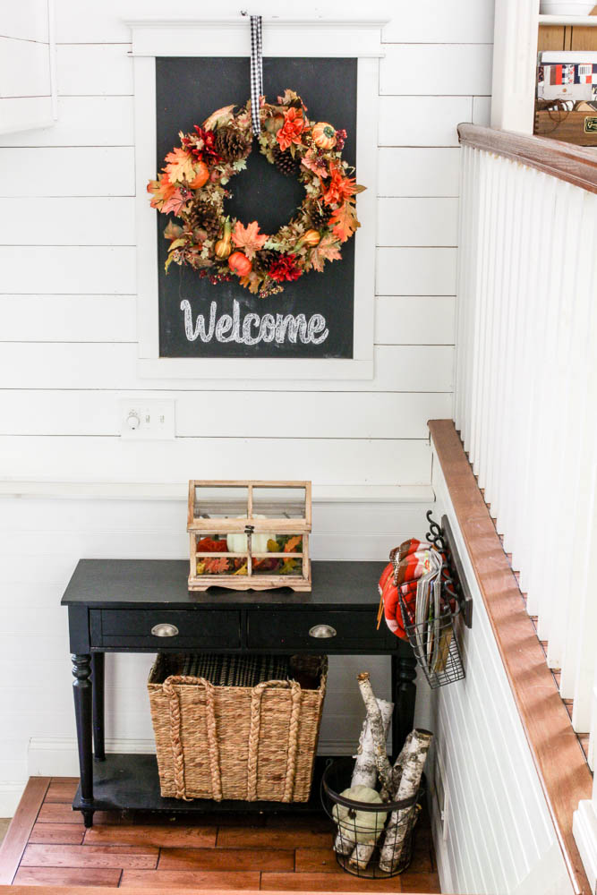 Planked walls in split level entryway with chalkboard and fall decor - www.goldenboysandme.com