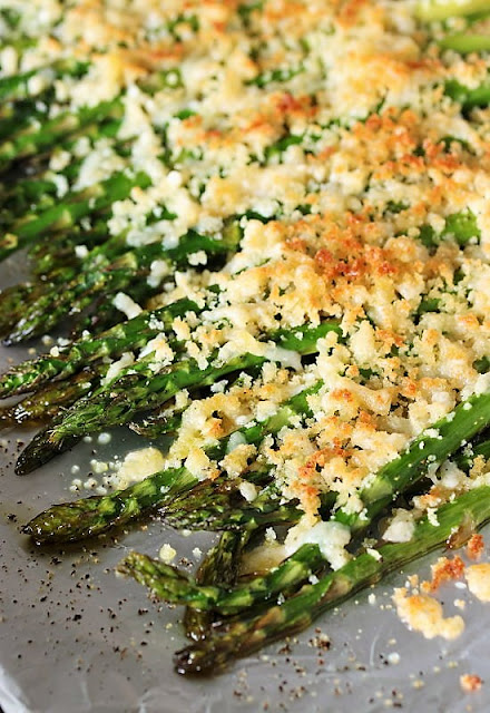 Baking Sheet of Roasted Asparagus with Crunchy Parmesan Topping Image