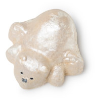 A white large polar bear shaped bubble bar laying down on a bright background