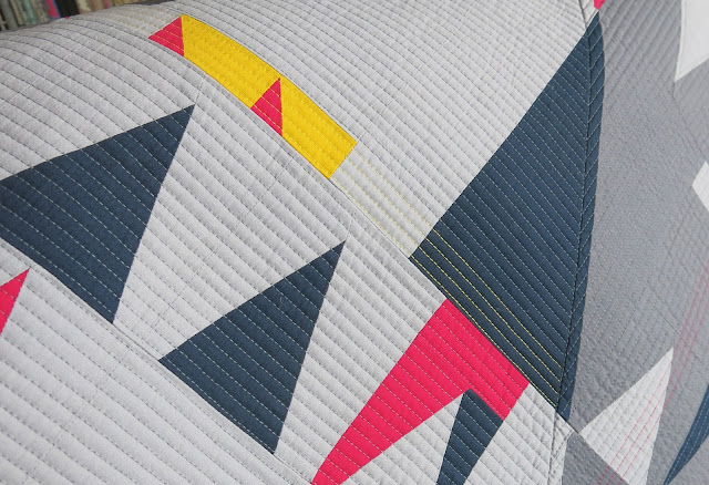 Luna Lovequilts - Improv triangles quilt - Straight line quilting detail