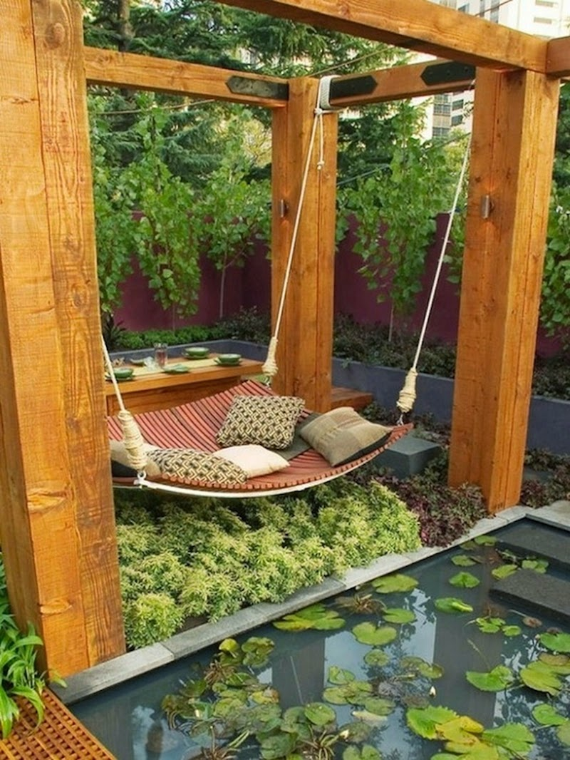 18. Nothing compares to this intricately detailed garden bed, made for naps and snacks–check out the table behind the swinging hammock! - 21 Places to Take a Nap Straight Out Of Your Fantasies