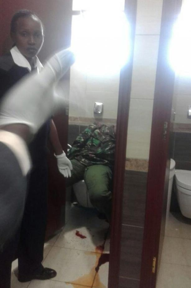 Hard times: Policewoman shoots herself dead inside airport toilet (graphic)