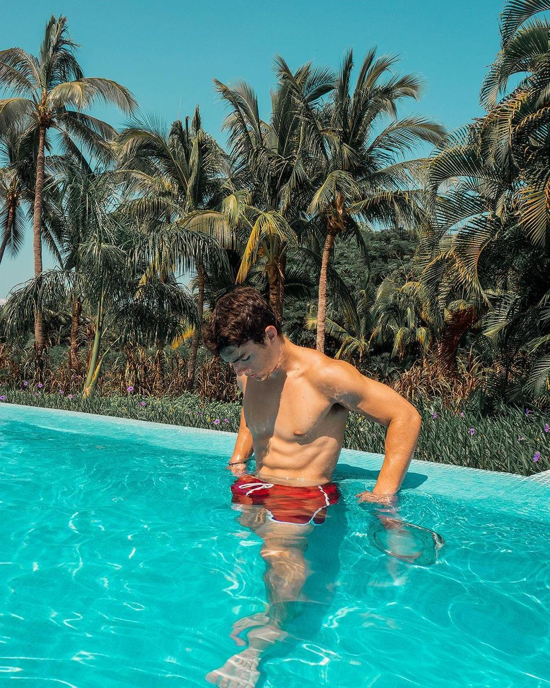 fit-shirtless-pool-boy-keith-laue-wet-body-palms-summer