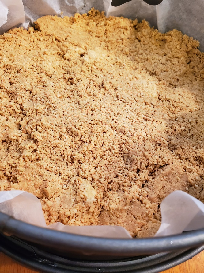 This is a cookie crust on the bottom of a springform pan lined with parchment paper
