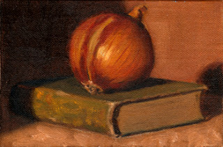 Oil painting of a brown onion on top of green linen-bound book.