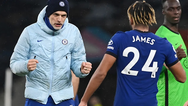 Chelsea boss Thomas Tuchel celebrates with Reece James after victory over Tottenham