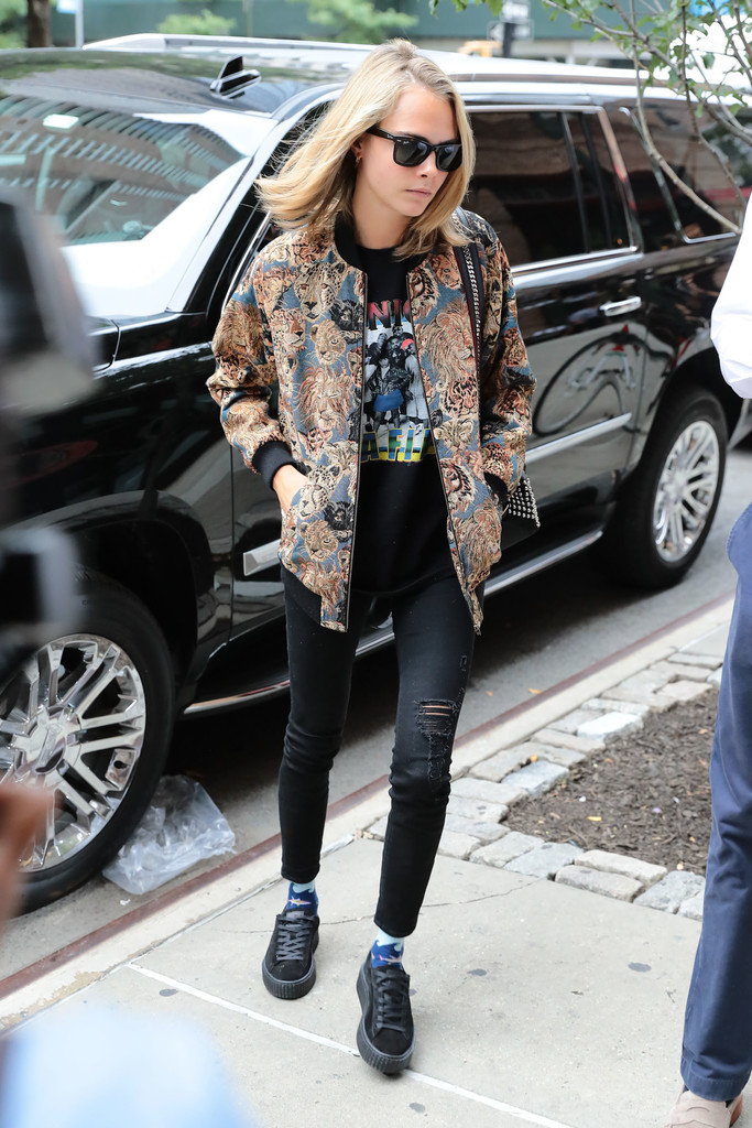 Cara Delevingne in an Animal Print Bomber in NYC