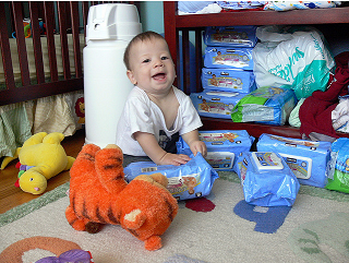 Image: Smiling at a fresh delivery of diaper wipes