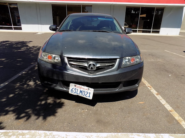 Faded Acura TSX before overall paint job at Almost Everything Auto Body.