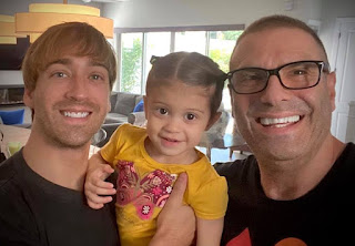 Jerry Penacoli with his partner Jackson and their daughter Olivia Grace