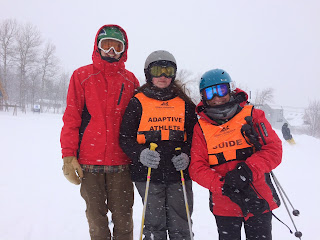 MOBALE skiers on the slope standing next to one another