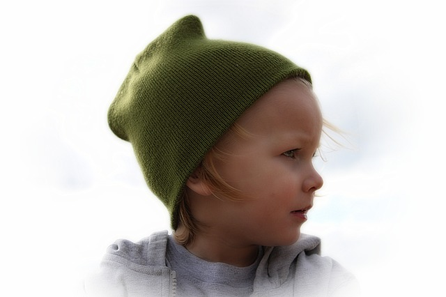 Image: Portrait of a baby boy in a green hat, by Greyerbaby / Lisa Runnels
