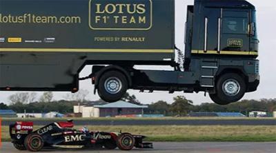 EMC Truck Breaks World Record By Jumping Over Speeding Lotus F1 Car