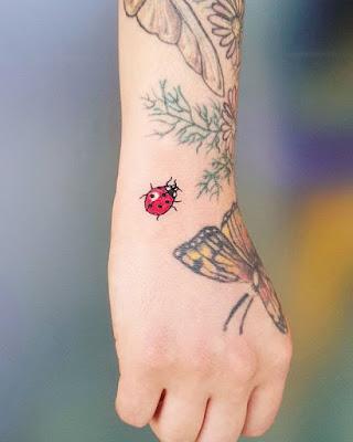 wrist ladybug tattoo for men