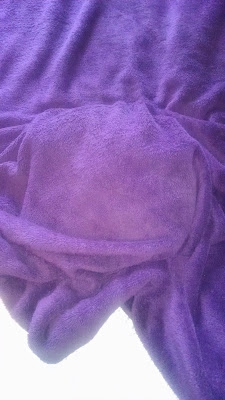 This only looks like a lumpy purple blanket