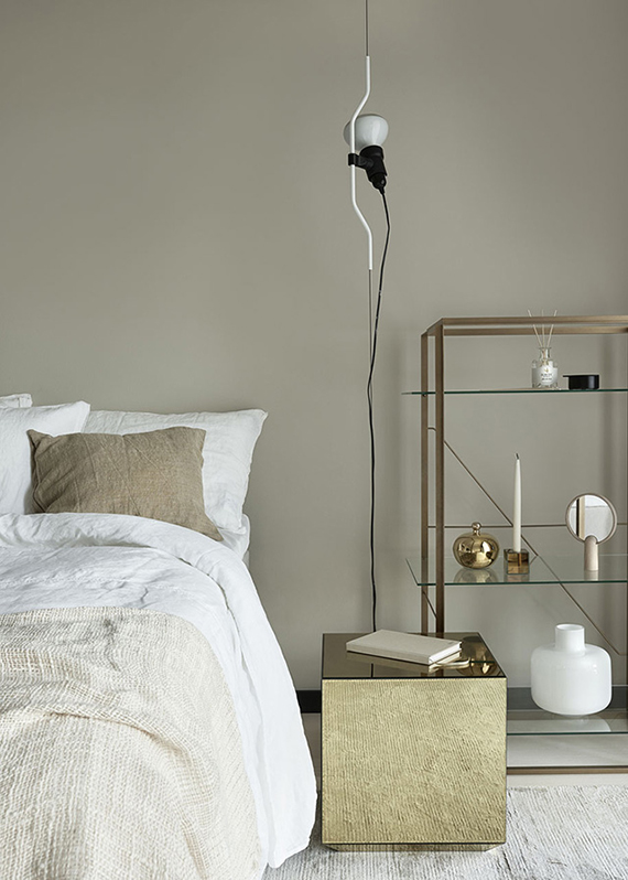 The Parentesi Lamp used as a bedside lighting in the bedroom | Interior design by Kirsi Valanti, styled by Susanna Vento and photographed by Riika Kantinkoski