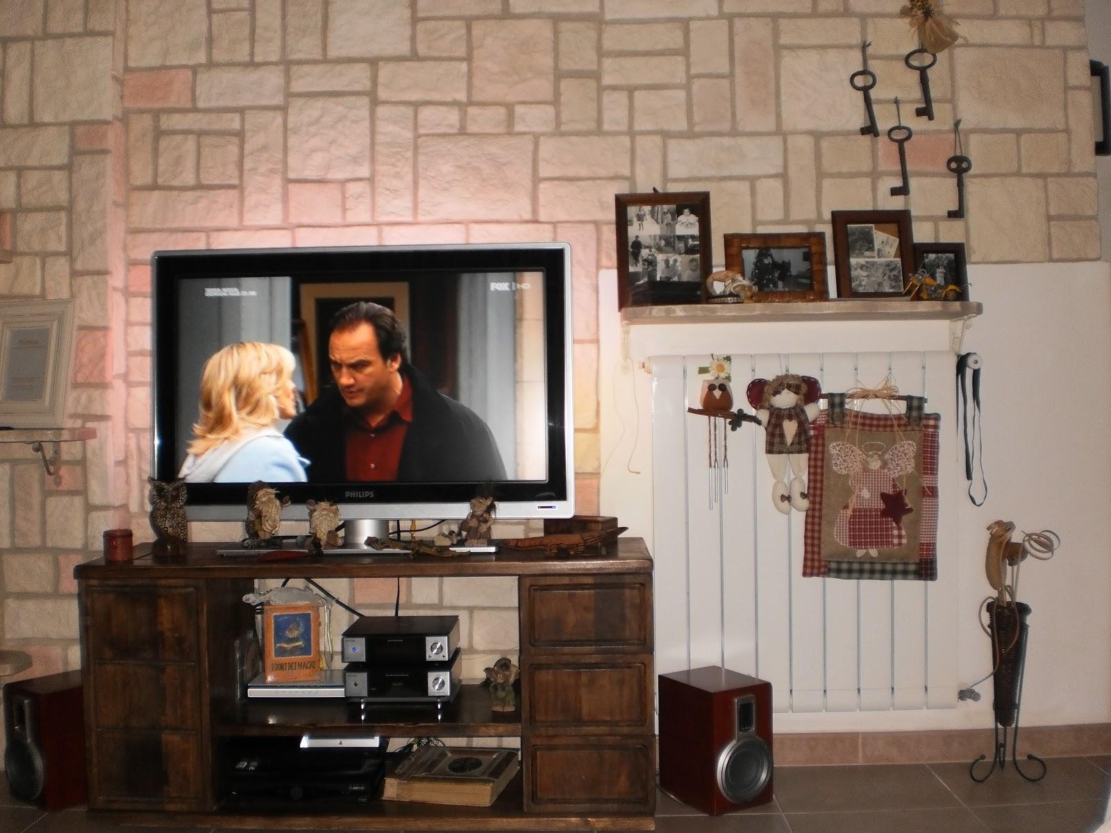 Iv soluzioni parete in pietra e mobile porta tv in arte for Parete in pietra con tv