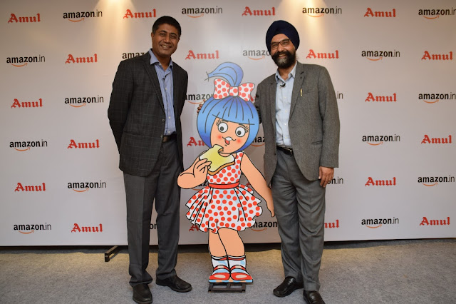 Gopal Pillai, Director & GM - Seller Services, Amazon India with R.S. Sodhi, Managing Director, GCMMF (Amul) announcing their exclusive p