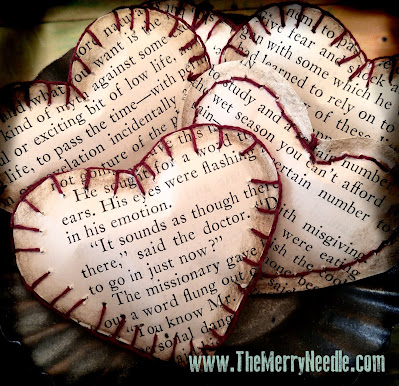 sewn paper hearts from book pages Valentines Day