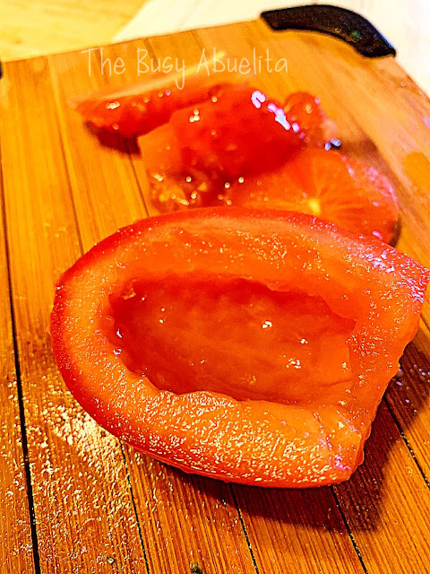 Deseeded tomatoes on cutting board