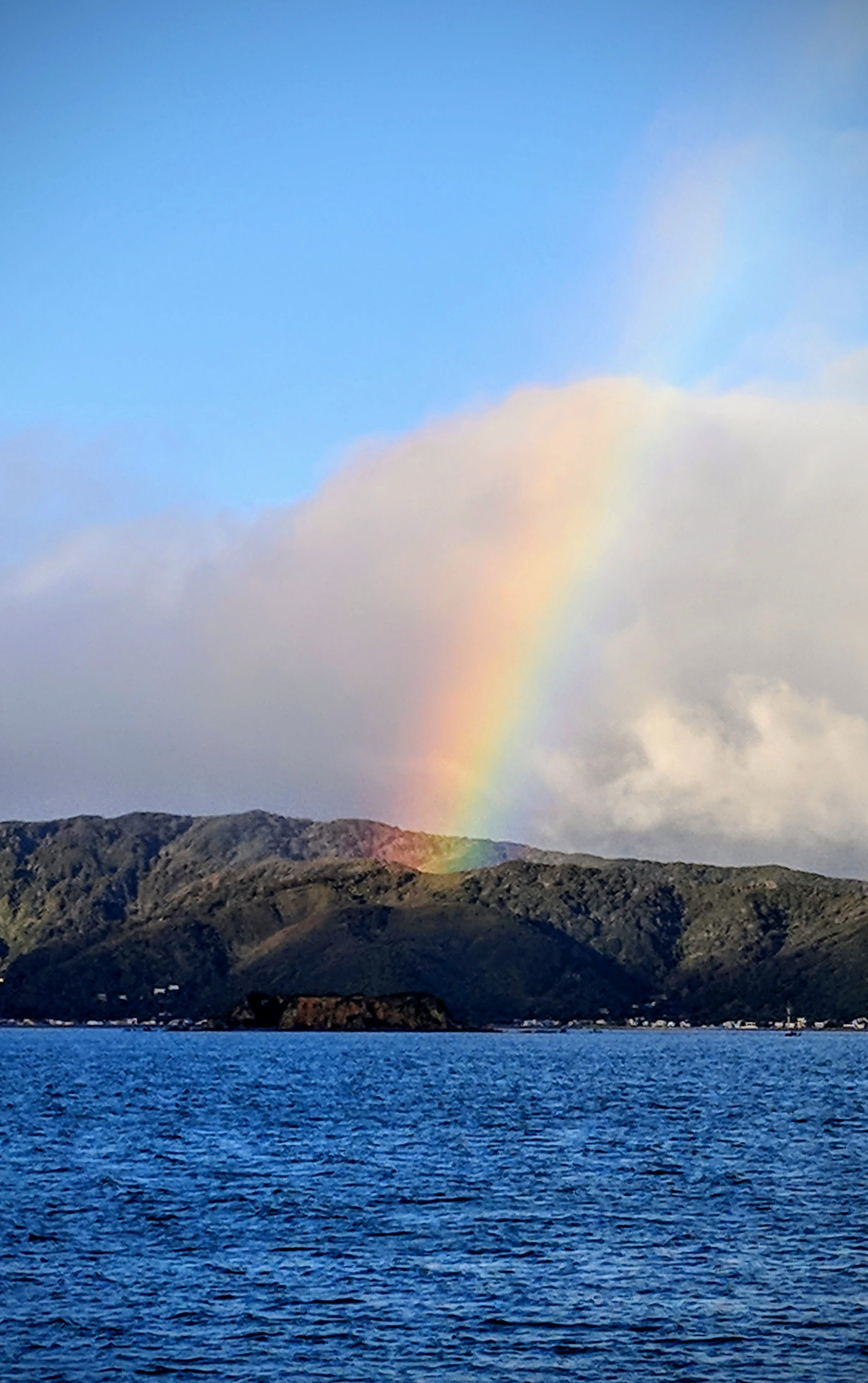 Maupuia hills brushed by rainbow colours