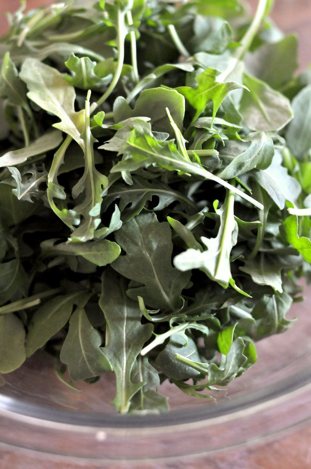 Fresh Baby Arugula in a Glass Bowl on tasteasyougo.com