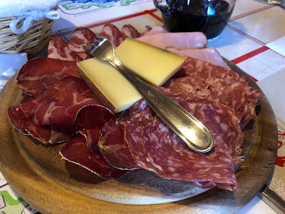 Lunch at Rifugio Bertone. Meat and cheese plate with fontina and mocetta.
