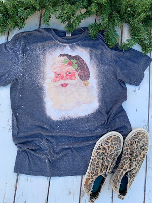 Santa with leopard print hat on bleached tee shirt
