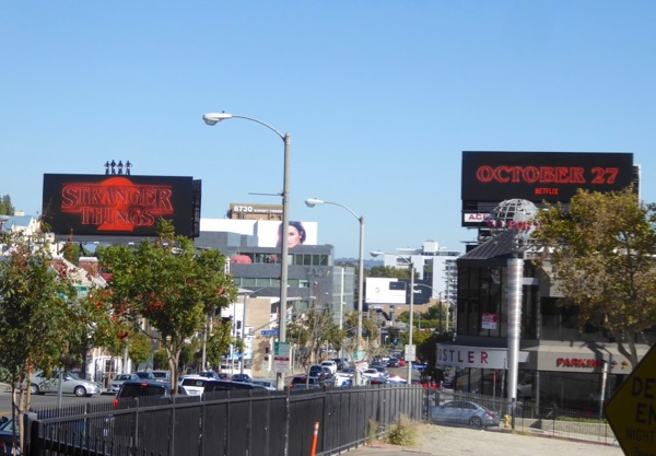 Stranger Things 2 neon sign billboards Sunset Strip day