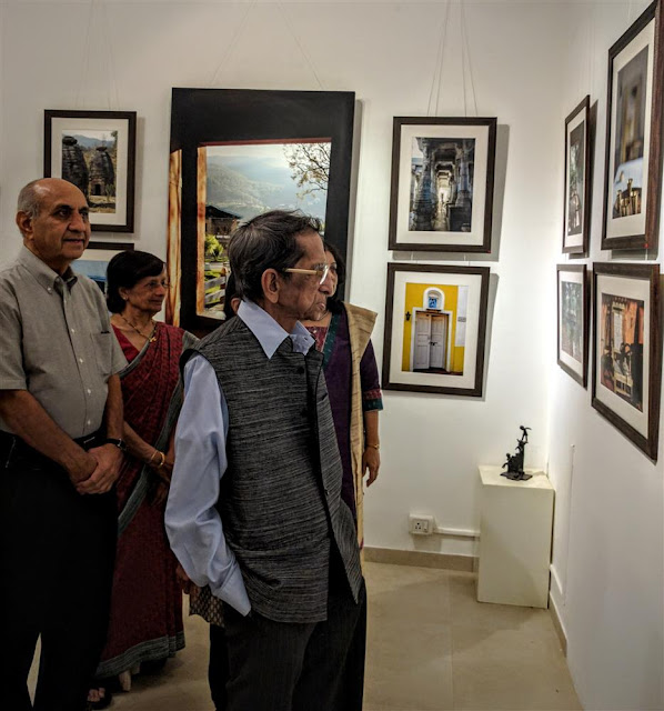 Shri. S. D. (Shi. Da.) Phadnis looking at the pictures at Milind Sathe's photography show at Indiaart Gallery, Pune