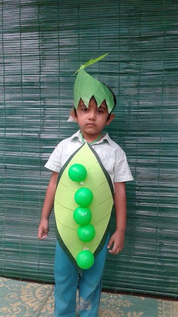 ideas para un disfraz de guisante para niños escolares. El disfraz se hace con cartulinas