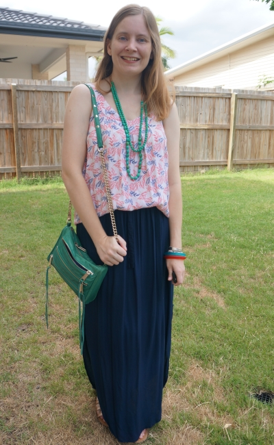 subtle red and green Christmas shopping outfit with navy maxi skirt | away from the blue