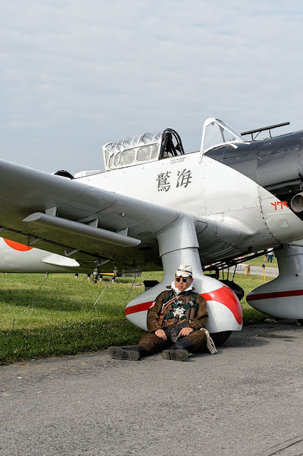 Re-Enactor sits under the wing of a replica Japanese Aichi Val