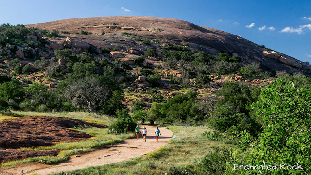 hikers on the trail below Enchanted Rock