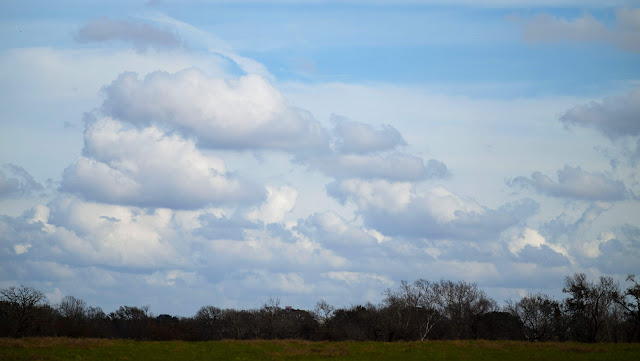 Puffy clouds in a big Texas sky between Austin and Houston