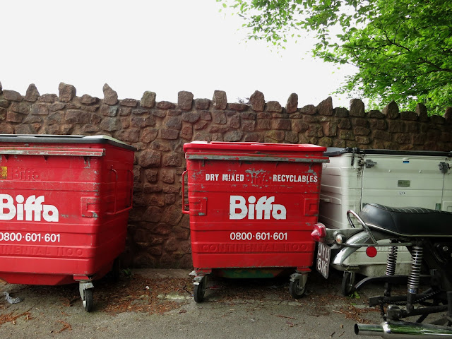 Two large rubbish bins on wheels