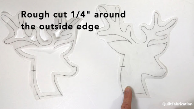 rough cutting around the drawn deer tracing on fusible web  by QuiltFabrication