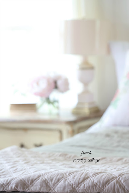close up of blush quilt details on bed