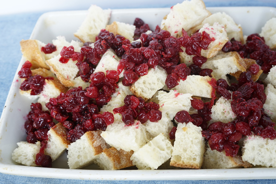 Making cranberry bread pudding