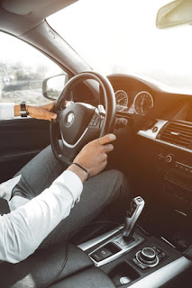 man-holding-steering-wheel